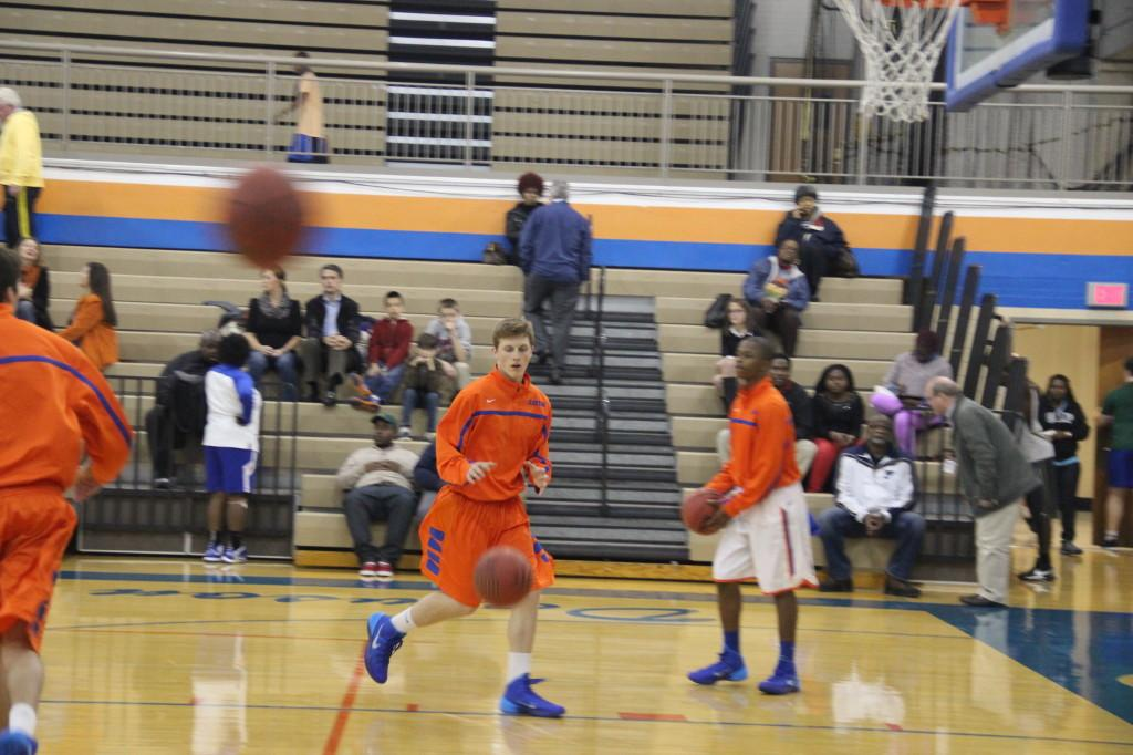 The boys' varsity basketball team warms up before their most recent match (Patrick Butler).